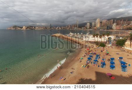 Editorial Benidorm, Spain - October 8, 2017: Holiday makers on the smallest beach in Benidorm, Mal Pas Beach, on the eastern coast of Spain, part of the Costa Blanca