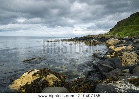North Antrim coastline in northern Ireland with clouds