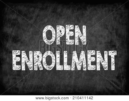 Open enrollment. Black board with texture. health care and business background.