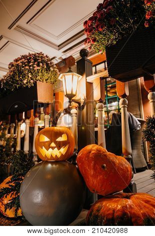 concept of celebrating a Halloween day. Decorative decoration of the street near the cafe in the evening.