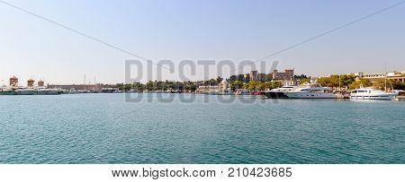 Panoramic landscape of Rhodes town harbor. Mediterranean sea, Rhodes island, Greece