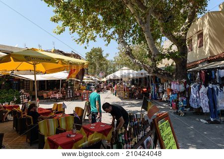 RHODES, GREECE  AUGUST 2017: Street with many bars and souvenir shops in Rhodes town. Rhodes island, Greece