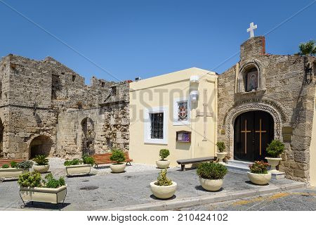 Small Greek church mounted in wall of old fortress in Rhodes town on Rhodes island