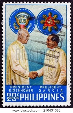 PHILIPPINES - CIRCA 1960: a stamp printed in Philippines shows presidents Eisenhower and Garcia and presidential seals circa 1960