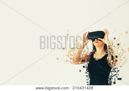 A person in virtual glasses flies to pixels. The woman with glasses of virtual reality. Future technology concept. Modern imaging technology. Fragmented by pixels