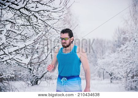 Hungry Northern Bearded Naked Man Devouring Snow.