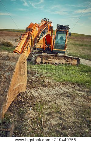 Tipner Portsmouth UK, August 2017.   Excavator on Disused land.