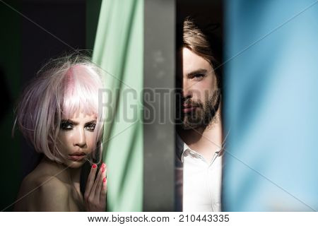 Couple Of Woman And Man Separated By Green Blue Wall