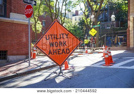 BOSTON MA, USA - OCTOBER 4, 2017: Utility work sign in Beacon Hill. Urban scene.  Utility crew working in Boston, Massachusetts, USA