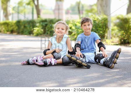 Cute little roller skaters in park