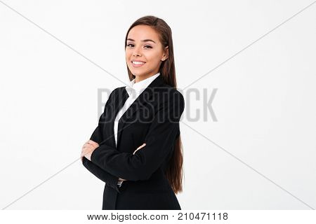 Image of amazing cheerful business woman standing with arms crossed isolated over white background. Looking camera.