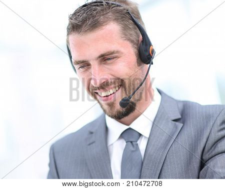 Happy  man working at callcenter, using headset