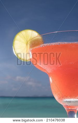 Closeup strawberry Daiquiri cocktail at the beach restaurant with beautiful blue sea and sky background