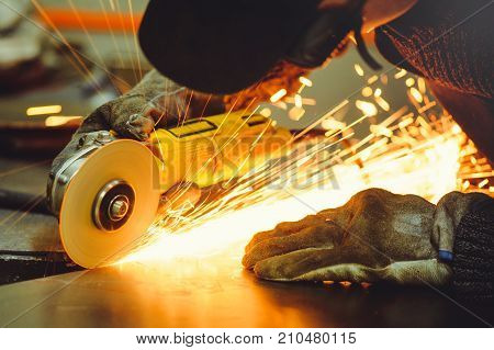 Male Angle Grinder During Operation
