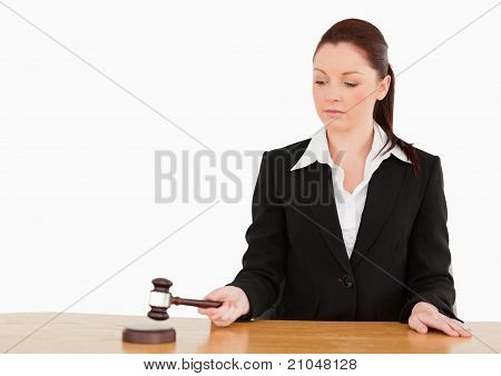 Young Judge Knocking A Gavel