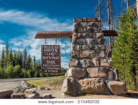 Crater Lake National Park United Stats: July 24th 2017: Crater Lake North Entry Sign in middle of summer