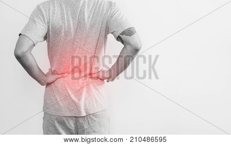 a man touching his back, with red highlight concept of back pain and waist pain concept, on white background.