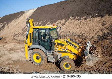 Tractor loader backhoe digger loader on a construction site with blue sky