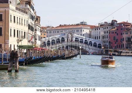 VENICE ITALY SEPTEMBER 22 2017: Rialto Bridge (Ponte de Rialto) over Grand Canal. It is the oldest bridge across the canal