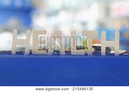 Word HEALTH with blurred colorful background. Health care background.