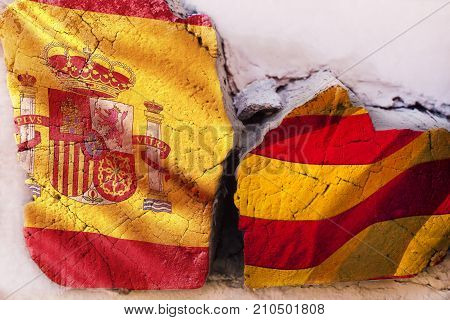 Symbol of crisis relations between countries. Broken square log wood with flags of Spain and Catalonia. Independence of the catalonia. Departure from Spain. A crisis. Barcelona, Spain.