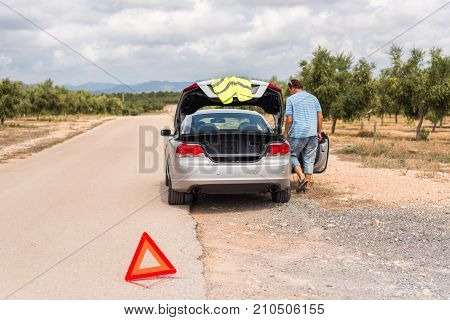A Man On The Road Is Waiting For Help. The Car Broke Down. Copy Space For Text.