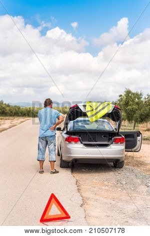 A Man On The Road Is Waiting For Help. The Car Broke Down. Copy Space For Text. Vertical.