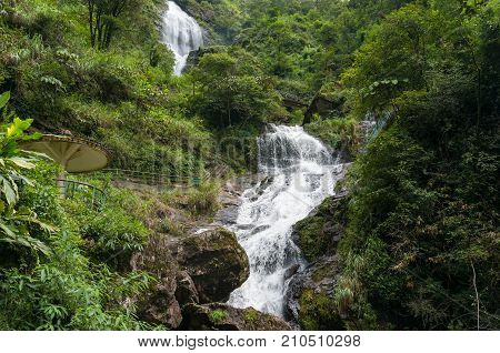 Silver waterfall landscape with tourism infrastructure. Vietnam