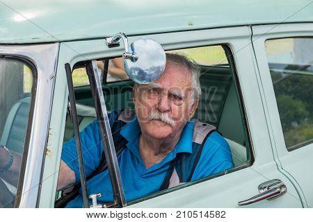Senior Man Sit Inside The Dodge Coronet(1956) Presented On Annual Oldtimer Car Show, Israel