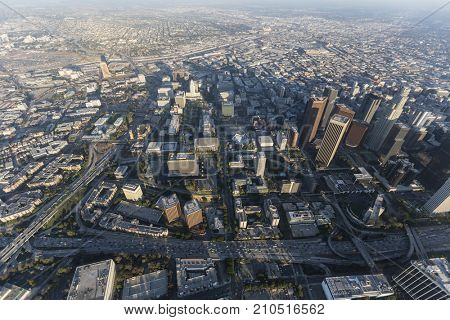 Smoggy summer afternoon aerial view of downtown Los Angeles Civic Center and Bunker Hill in Southern California.
