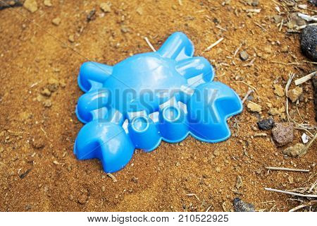 Children's blue sand mold in shape of crab