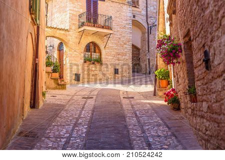 SPELLO, ITALY - MAY 27 2017 - View of a typical alley of Spello a medieval and beautiful town in Umbria.