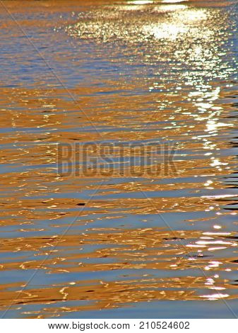 Beautiful reflection of the sun's rays on the water.