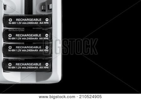 AA rechargeable battery pack with black background and copy space.