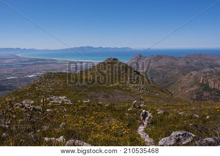Hikers climb a trail in the mountains near Cape Town, South Africa
