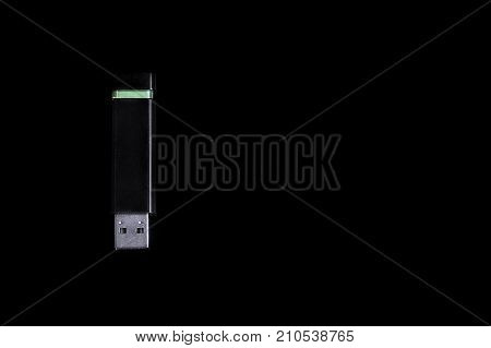 Computer accessory, USB Flash drive memory stick isolated on black background