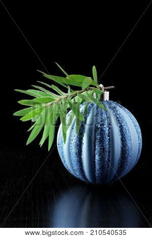 Blue Christmas Bauble on a Black Background