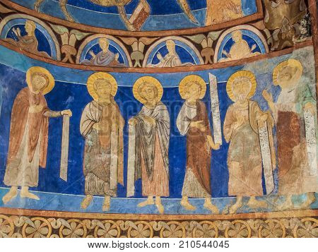 Six disciples with texts in a medieval wall-painting a romanesque mural in Bjaresjo church Sweden November 6 2009
