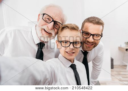 Family In Formal Wear Taking Selfie
