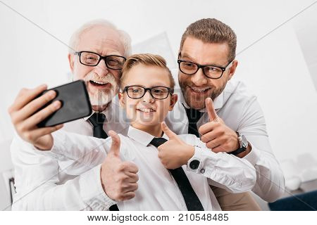 Family In Formal Wear Taking Selfie