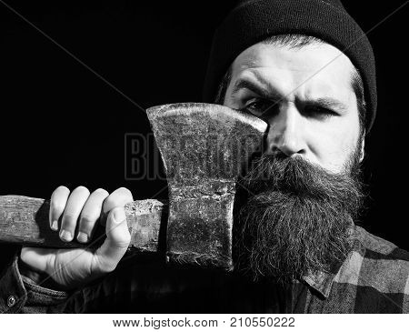Handsome Bearded Man In Hat Holds Axe On Black Background