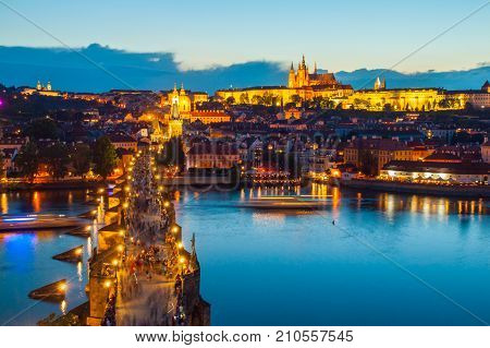 Hradcany evening panorama with Prague Castle, Charles Bridge and Vltava River, Prague, Czech Republic.