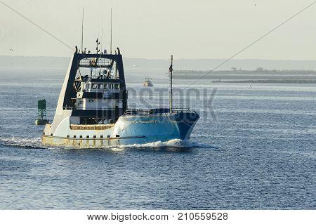 New Bedford Massachusetts USA - October 23 2017: Fishing vessel Sea Watcher I entering New Bedford harbor on foggy morning