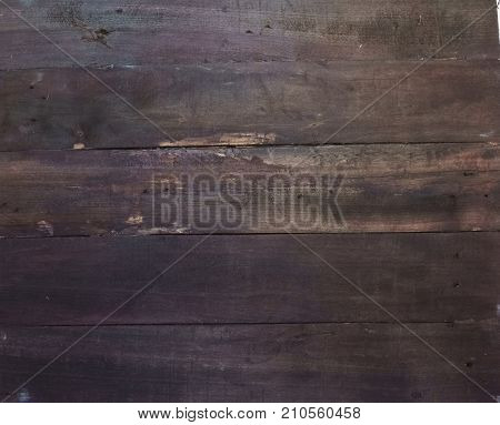 Wooden background. Texture, the surface of the old boards from natural wood with different shades of black and dark brown. The top view. Close-up. The stock photos.
