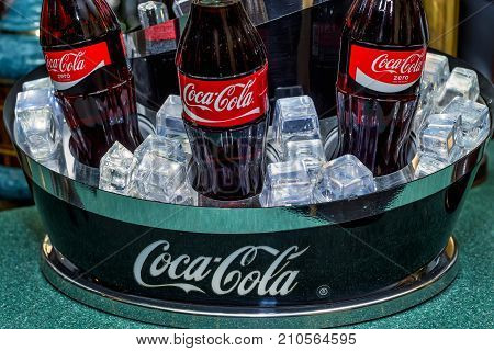 KISLOVODSK, RUSSIA - CIRCA MAY 2017: Coca-Cola bottles on tray with ice cubes