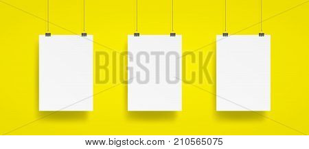 Blank Three Hanging Poster With Clip And Wire Mockup Vector On Yellow Background. Mockup Concept