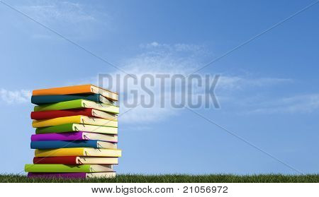 A Stack Of Books Over Grass