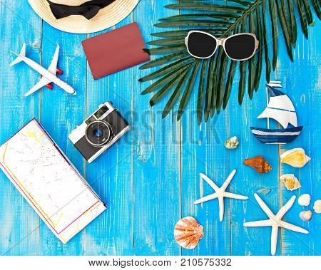 Summer accessories camera and sunglasses go to travel in the beach. Tropical sea.Unusual top view. Travel and Summer Concept.