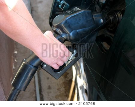 Person Pumping Gas