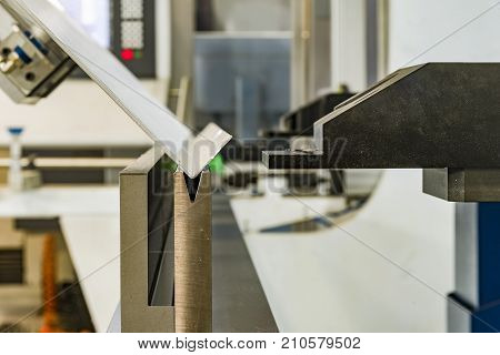 operator bending metal sheet by sheet bending machine bending of metal